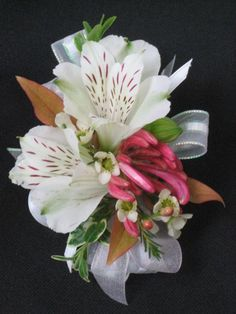 Alstromeria corsage with a bit of honeysuckle blossom