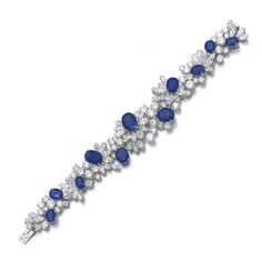 Sapphire and diamond bracelet, Alexandre Reza Set with oval and cushion-shaped sapphires, highlighted with clusters of marquise-shaped and brilliant-cut diamonds, length approximately 190mm, signed A. Reza, French assay and maker's marks, case stamped Alexandre Reza. ||| sotheby's ge1605lot8pm4zen