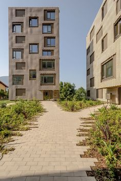 Image 7 of 31 from gallery of Le Stelle Housing / Buzzi Architetti. Photograph by Marcelo Villada Brick Architecture, Contemporary Architecture, Landscape Architecture, Amazing Buildings, Modern Buildings, Building Exterior, Building Design, Social Housing, Facade Design