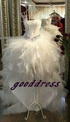 Feather wedding dress...different but I kinda like it!