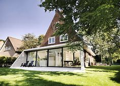 Dutch classic home that has modern extension.