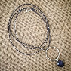 Sodalite and sterling silver ring pendant on long navy blue braided, beaded cotton cord necklace by MiiMyxJewelry on Etsy https://www.etsy.com/listing/225680478/sodalite-and-sterling-silver-ring