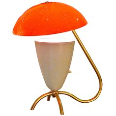 1950's Italian Orange Flowerpot Lamp  Italy  1950's  Merry little Italian table lamp from the 1950's with a brass tri-pod base and an enameled Arteluce style uplight cone with an acrylic orange dome as reflector.