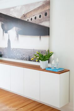 Floating sideboard with ikea over-fridge cabinets and custom planed wood top