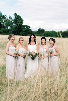 Bridesmaids wear Silver Gowns from Mint Velvet - Image by Renata Fry - Rustic Wedding At Buckettsland Farm With Bride In Grecian Style Gown From Coast And Bridesmaids In Silver Dresses From Mint Velvet