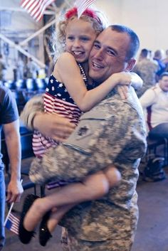 The hug that means everything in the world...  A member of Oklahoma National Guard's 45th Infantry Brigade Combat Team returns home from Afghanistan.  http://www.OperationWarriors.org