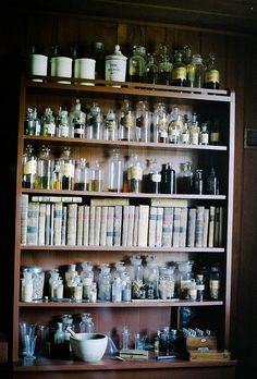 Vintage medicines, books, and tools on display.
