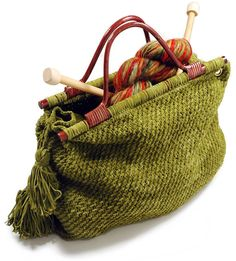 """Our popular knitting tote is sturdy and stylish in Suede. Size Approximately 15"""" wide x 11"""" high (Not including handles) x 4 1/2"""" deep. Materials Berroco Suede(50 grs), 5 balls #3715 Tonto Green or #3745 Calamity Jane Purple or # 3769 Sundance Kid Turquoise 24"""" length circular knitting needle, size 8 OR SIZE TO OBTAIN GAUGE. Crochet hook, size 4.00 mm (F). 1 Pair wooden handles with 13"""" wide bar at bottom. Four 7/16 """" goldtone grommets."""