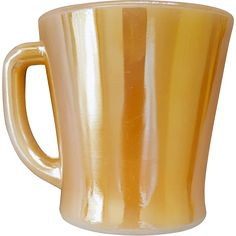 Fire King D handle coffee mug / cup with peach luster, marigold finish. Never used. Marked: Oven, Fire King, Ware, 14 Made in the USA. It is 3-1/2