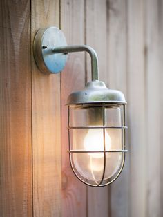 barn lamp in shutter blue exterior garden wall lighting solution