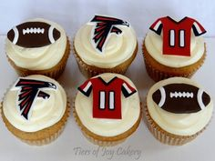 Atlanta Falcons football cupcakes with handmade fondant decorations.