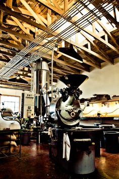 Behind the cafe, in an open air loading dock, is the roasting facility at Four Barrel.