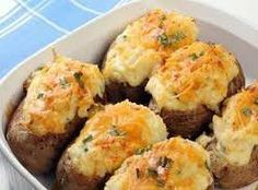 3 potatoes, 1/2 c. chicken broth, 1 c. milk, shredded cheese, onion slices, 1/4 c. sour cream, 1 tsp. dijon mustard, 1/4 tsp paprika 400 degrees, pierce potatoes, bake 1 hr 25 min, cut in half, scoop out centers. Mix all ingredients, put back in shells, add cheese on top. Bake 20 minutes.