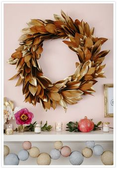 gold magnolia leaf wreath--this is an xmas decoration I could get behind.