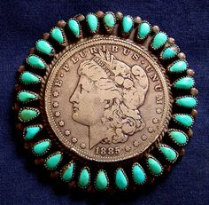 Vintage Pawn Navajo 1885 Silver Dollar Pin with Turquoise stones going all the way around the edge of the Silver Dollar. Made circa 1930