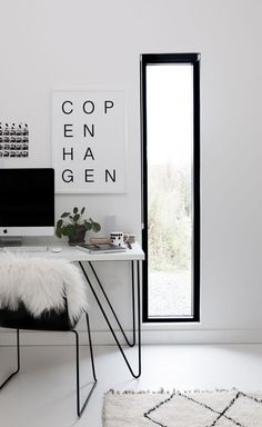 Copenhagen black and white print by SOOuK - Scandinavian workspace with berber rug and sheepskin