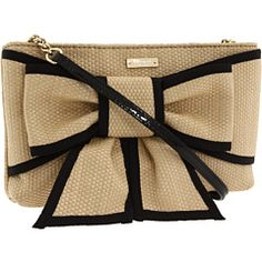 The Kate Spade New York™ Mount Perry Adira l Shoulder bag made of tightly woven straw with grosgrain trim.