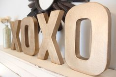 """Craft store cardboard letters, spray paint silver.  For above the closet, you could use """"HOME"""" or something fun"""