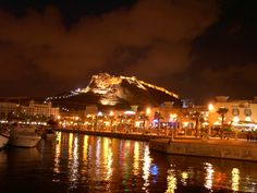 Port of Alicante, Spain with oldest Moorish Castle on top of Rock Mountain in Background.
