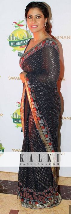 Kajol: She never fails to mesmerize her fans with her never ending charisma and graceful dress sense. Dressed in a shimmer royal blue saree with printed borders, she was seen dazzling at the 'Swabhimani Mumbaikar' event.