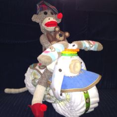 Motorcycle-riding sock monkey made for baby shower.