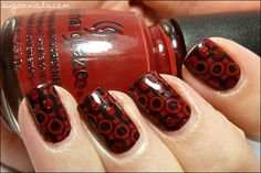 China Glaze City Siren as the base, stamped with Bundle Monster plate BM322 and black Konad polish, then filled some of them with China Glaze Ruby Pumps using a dotting tool. From: Sweet Sugar, Sunday Stamping Challenge, Red & Black
