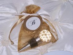 Crystal/gold wine bottle cork as a wedding favor with a monogram tag as the tie
