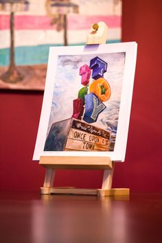 Entire 2013 Steve Hartman painting collection in Giclee prints with wooden easel. $500