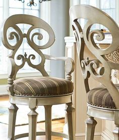 Graceful and elegant, the Louisa Swivel Bar and Counter Stool boasts generous proportions and plush comfort to create an inviting seat at your parties.