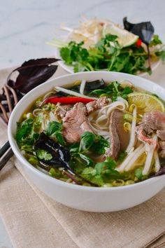 Pho is a Vietnamese noodle soup topped with awesome things like fresh bean sprouts, basil, and chilies. This pho recipe was approved by a Vietnamese friend! Mie Noodles, Beef And Noodles, Pasta Noodles, Vietnamese Cuisine, Vietnamese Noodle, Healthy Vietnamese Recipes, Soup Recipes, Cooking Recipes, Recipes