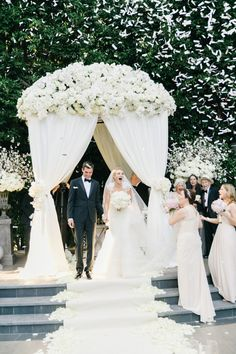 Gorgeous white rose covered ceremony alter: http://www.stylemepretty.com/2015/12/31/glamorous-beverly-hills-ballroom-wedding/ | Photography: Jana Williams - http://jana-williams.com/