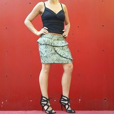 """🚨REDUCED🚨💋HP💋Fun Skirt with ruffle details 💋Honored Host Pick💋 Super cute shimmery skirt in colors of green, tan, charcoal and silver. Ruffles details are on front and back of skirt. Side zipper, Fully lined Material is 61%polyester,  39% viscose  Skirt is new. Never worn.  Size medium Waist side to side approx 15"""" Length approx 14.5"""" Skirts"""