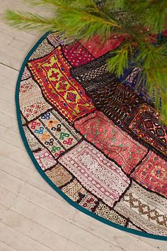 Anthropologie - Patchwork Tree Skirt: Very pretty itself, but makes me think of all the things I could do with some of the quilts, doilies, etc. we've received from grandparents. Ideas! Ideas!
