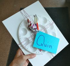 art-themed party favors : canvas board, paint tray, paintbrushes and a treat