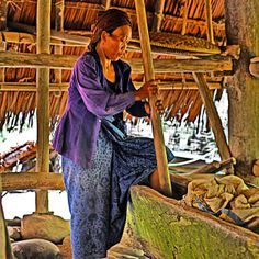The sound of Baduy women pounding rice grain can be heard from afar when we walk around the village