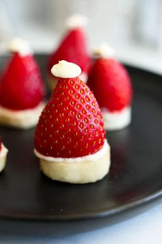 Strawberry Banana Santa Hats- This is SO EASY and such a fun Christmas dessert for kids. Santa Hats are made with strawberries, bananas, and white chocolate. Healthy too!!