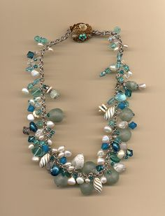 Beach glass, pearls, crystals, vintage beads, vintage clasp.  Made by Manya Vee for a September bride.