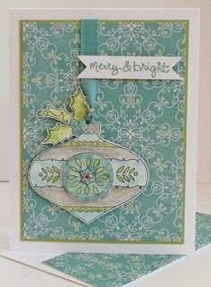 """Merry Bauble by Heather D Heroldt, Christmas Bauble & Good Greetings Stamp Sets; All Is Calm DSP; Whisper White & Pear Pizzazz CS; Lost Lagoon, Smoky Slate, Pear Pizzazz & Soft Sky Inks; 1 1/4"""" Circle Punch; Bitty Banners Framelits; Lost Lagoon Silky Taffeta Ribbon; Linen Thread; Basic Jewel Rhinestones."""