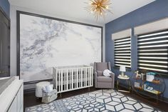 A modern, serene and sophisticated nursery with cool grays and blues, complemented by unexpected gold.