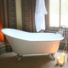 The Bourdeaux Cast Iron Bath, available from Ribble Reclamation.  White with chrome feet