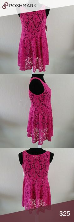 """Free People Hot Pink lace dress szXS Beautiful Hot Pink lace dress by Free People is brand new..does not come with the slip it is sold with at stores. The price will reflect this. There are so many layering options for this piece. Im sure the buyer of this dress will wear it well and look amazing. The color is gorgeous!! length from under arm down to hem is 24"""" this is the same dress I also have listed in cream Free People Dresses Mini"""