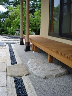 Step down from a wraparound porch into a Japanese garden.