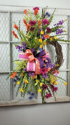 Wildflower wreath, Spring wreath, Summer wreath, Colorful wreath, Whimsical wreath, Spring/Summer decor, Front door wreath This gorgeous spring wildflower wreath is a must have for anyones front door. It is loaded with the most beautiful flowers in every color of the season. Made