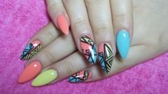 Turquoise, yellow and pink stiletto nails