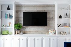 Styled white built in cabinets flank a barn board wall fitted with a flat panel . - Styled white built in cabinets flank a barn board wall fitted with a flat panel television mounted - Built In Tv Cabinet, White Tv Cabinet, Tv Built In, Built In Cabinets, Built In Shelves, Tv Cabinets, Built In Tv Wall Unit, White Cabinets, Wall Mount Tv Cabinet