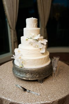5 tiered wedding cake draped in white orchids: http://www.stylemepretty.com/texas-weddings/dallas/2014/12/10/understated-elegance-in-dallas-texas-at-brookhollow-golf-club/ | Photography: Nicole Berrett - http://www.berrettphotography.com/