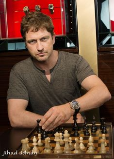 Gerard Butler playing chess in Dubai. -   A Scot playing chess -  just so cool.