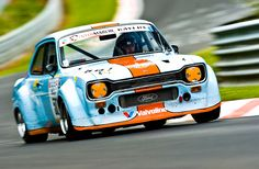 A Ford Escort MKI with the Gulf livery running wild at the Nurburgring? Where do I signup?