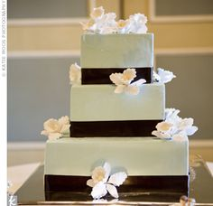 love the sugar orchids.  Maybe could reverse with a white round cake, black ribbon, and teal orchids?