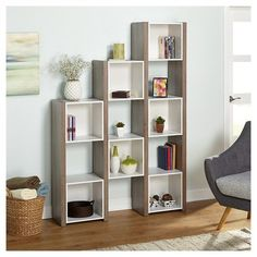 The bookcase with a reclaimed finish is way to keep everything organized and your space clutter free. The unit features seven enclosed cubes and open shelving to display photos, collectibles and books. You will love the versatility of this piece place against the wall or use as a room divider. Cube dimensions: 13 inches high x 12.8 inches wide x 10.5 inches deep.